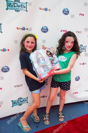 """McKayla Twiggs, right, and friend attend the """"La Dee Da"""" launch party hosted by Spin Master Ltd. on in New York City's Times Square"""