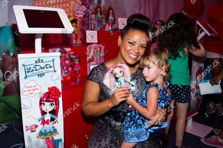 "Kimberley Locke and friend attends the ""La Dee Da"" launch party hosted by Spin Master Ltd. on in New York City's Times Square"