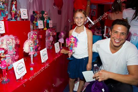 """Erik Palladino and his niece attend the """"La Dee Da"""" launch party hosted by Spin Master Ltd. on in New York City's Times Square"""