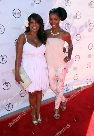"Niecy Nash, left, and Kita Williams arrive at Robi Reed's 10th Annual ""Sunshine Beyond Summer"" Celebration - The Day Party with a Purpose at the Getty House, in Los Angeles"