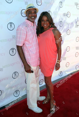 """Phil Wilson of the Black AIDS Institute, left, and Rolonda Watts arrive at Robi Reed's 10th Annual """"Sunshine Beyond Summer"""" Celebration - The Day Party with a Purpose at the Getty House, in Los Angeles"""