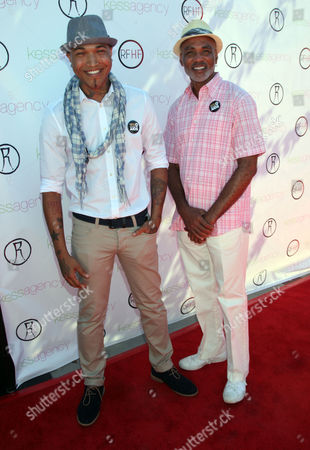 """Jamar Rogers, left, and Phill Wilson of the Black AIDS Institute arrive at Robi Reed's 10th Annual """"Sunshine Beyond Summer"""" Celebration - The Day Party with a Purpose at the Getty House, in Los Angeles"""