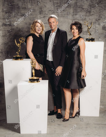 Stock Image of Kristen Comings, Steven Walberg, Stefanie Mohr poses for a portrait at the Television Academy's 67th Emmy Awards Performers Nominee Reception at the Pacific Design Center on in West Hollywood, Calif