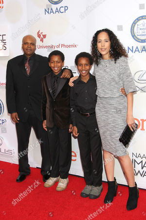 Curtis Harris Bythewood, from left, Gina Prince-Bythewood, and children arrive at the 46th NAACP Image Awards at the Pasadena Civic Auditorium, in Pasadena, Calif