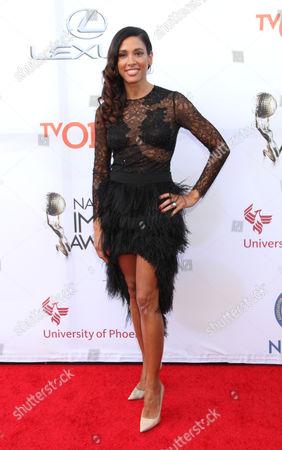 Kristen Baker Bellamy arrives at the 46th NAACP Image Awards at the Pasadena Civic Auditorium, in Pasadena, Calif