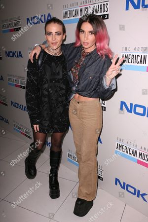 Fiona Fitzpatrick, left, and Rebecca Scheja are seen at The Electronic Dance Music Party at the American Music Awards, on in Los Angeles