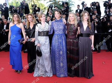 From left, Carole Franc, Claire Keim, Isabelle Carre, Lou De Laage, Melanie Laurent and Josephine Jappy arrive on the red carpet for the screening of The Homesman at the 67th international film festival, Cannes, southern France