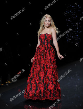 Stock Photo of Anna Sophia Robb walks the runway at the The Red Dress Collection 2014 on in New York