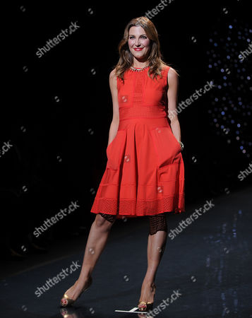 Thea Andrews walks the runway at the The Red Dress Collection 2014 on in New York