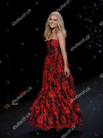 Stock Picture of Actress Anna Sophia Robb models an outfit from the 2014 Red Dress Collection on in New York