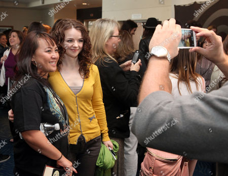 Marlane Barnes poses for a photo with a fan at the Time Warner Cable and Twilight Fan Breakfast on in Los Angeles