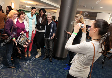 Tracey Heggins, Judith Shekoni and Noel Fisher pose for a photo with fans at the Time Warner Cable and Twilight Fan Breakfast on in Los Angeles