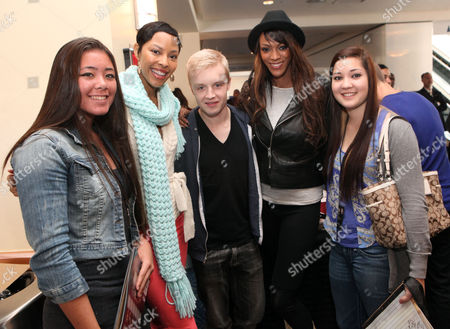 Tracey Heggins, Noel Fisher and Judith Shekoni pose for a photo with fans at the Time Warner Cable and Twilight Fan Breakfast on in Los Angeles
