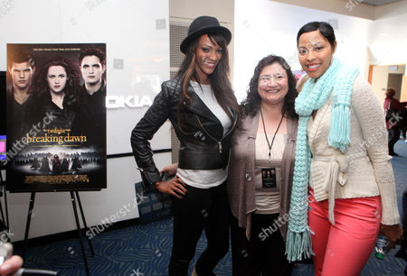 Judith Shekoni, left, and Tracey Heggins pose for a photo with a fan at the Time Warner Cable and Twilight Fan Breakfast on in Los Angeles