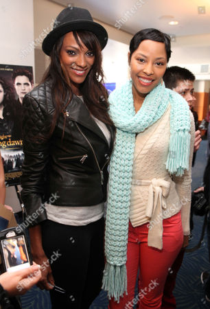 Judith Shekoni, left, and Tracey Heggins pose for a photo at the Time Warner Cable and Twilight Fan Breakfast on in Los Angeles