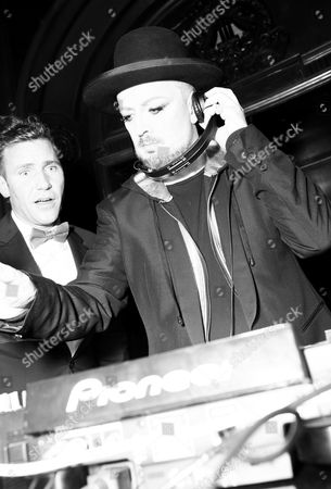 Stock Image of DJ Zen Freeman, left, and icon Boy George spin at Treats! Halloween with Absolut Elyx in partnership with Utsinger Entertainment at the Los Angeles Theatre on in Los Angeles, Calif