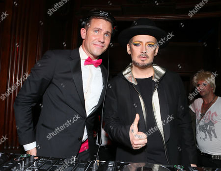DJ Zen Freeman, left, and icon Boy George spin at Treats! Halloween with Absolut Elyx in partnership with Utsinger Entertainment at the Los Angeles Theatre on in Los Angeles, Calif