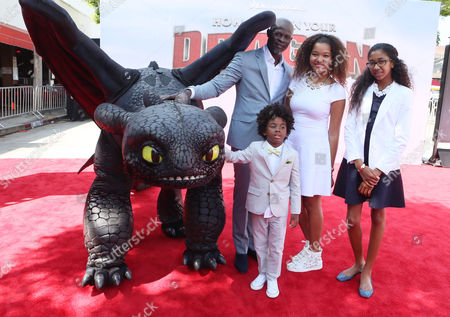 Djimon Hounsou, Kenzo Lee Hounsou, Ming Lee Simmons and Aoki Lee Simmons seen at the Twentieth Century Fox and DreamWorks Animation Los Angeles Premiere of 'How to Train Your Dragon 2', in Westwood, Calif