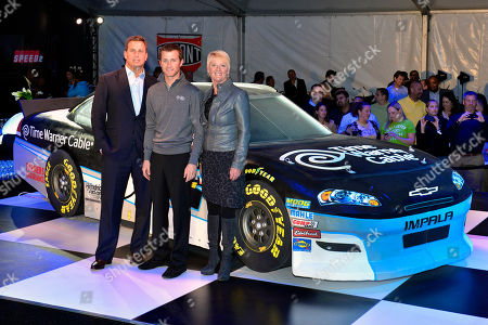 Jeff Hirsch Executive Vice President and Chief Marketing Officer, Kasey Kahne and Carol Hevey Executive Vice President, Time Warner Cable East region pose by the life sized cake replica of the Kasey Kahne No. 5 Time Warner Chevrolet, on in Charlotte, N.C
