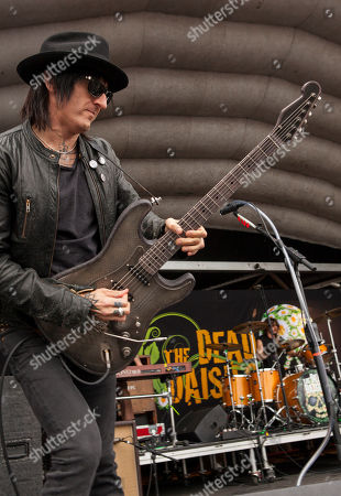 Richard Fortus and Alex Carapetis of The Dead Daisies perform during the Rockstar Energy Drink Uproar Festival at the First Midwest Bank Amphitheatre, on in Tinley Park, IL