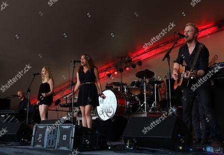 Eric Hölljes, Brittany Hölljes, Elizabeth Hopkins and Ian Hölljes of Delta Rae perform at the Voodoo Experience, in New Orleanse