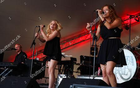 Eric Hölljes, Brittany Hölljes, Elizabeth Hopkins of Delta Rae perform at the Voodoo Experience, in New Orleanse