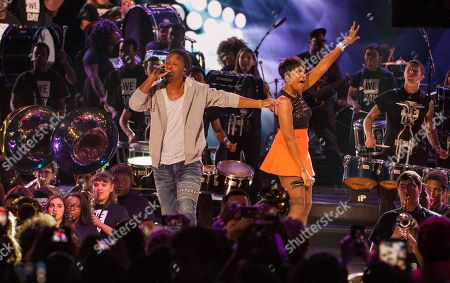 Hip-hop artist Lupe Fiasco and Grammy award-winner Jennifer Hudson perform during the We Day Illinois 2015 at Allstate Arena on in Chicago