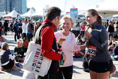 IMAGE DISTRIBUTED WOMEN'S HEALTH - From left, David Lauren, Sharon Bush and FEED CEO Lauren Bush Lauren enjoy the festival at the flagship 10K event of the nationwide Women's Health RUN 10 FEED 10 running series, on in New York. This program has raised nearly 800,000 meals to date
