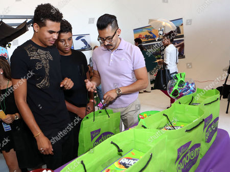 Randy Jackson Jr., left, and Jermajesty Jackson visit the WONKA Randoms candy bar at an Emmy Awards gift suite on in Los Angeles. Please visit WONKA's facebook page at www.facebook.com/wonka
