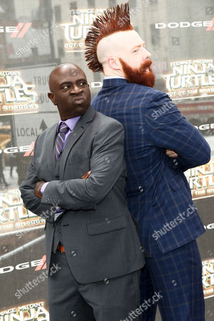 "Gary Anthony Williams, left, and Stephen Farrelly, right, attend the world premiere of ""Teenage Mutant Ninja Turtles: Out of the Shadows"" at Madison Square Garden, in New York"