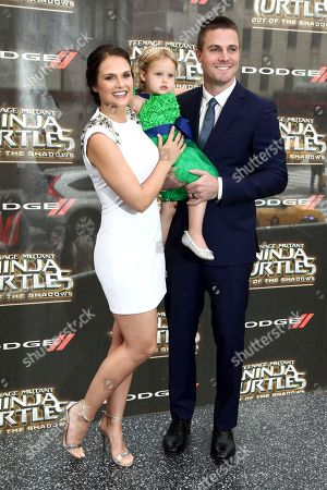 """Cassandra Jean, from left, Mavi Amell and Stephen Amell attend the world premiere of """"Teenage Mutant Ninja Turtles: Out of the Shadows"""" at Madison Square Garden, in New York"""
