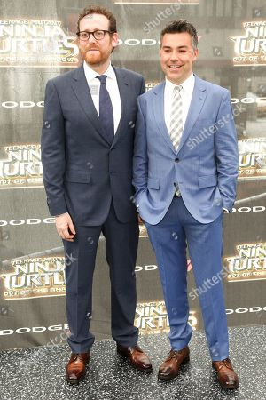 """Josh Appelaum, left, and Andre Nemec, right, attend the world premiere of """"Teenage Mutant Ninja Turtles: Out of the Shadows"""" at Madison Square Garden, in New York"""