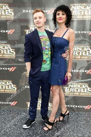 """Noel Fisher, left, and Layla Alizada, right, attend the world premiere of """"Teenage Mutant Ninja Turtles: Out of the Shadows"""" at Madison Square Garden, in New York"""