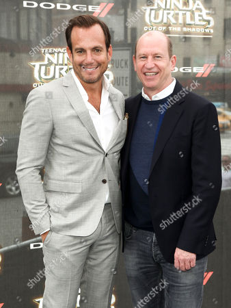 """Will Arnett, left, and Rob Moore, right, attend the world premiere of """"Teenage Mutant Ninja Turtles: Out of the Shadows"""" at Madison Square Garden, in New York"""