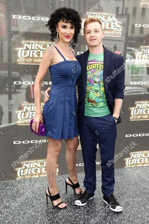"""Layla Alizada, left, and Noel Fisher, right, attend the world premiere of """"Teenage Mutant Ninja Turtles: Out of the Shadows"""" at Madison Square Garden, in New York"""