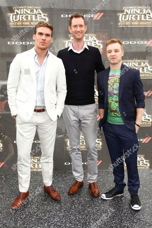 """Pete Ploszek, from left, Jeremy Howard and Noel Fisher attend the world premiere of """"Teenage Mutant Ninja Turtles: Out of the Shadows"""" at Madison Square Garden, in New York"""