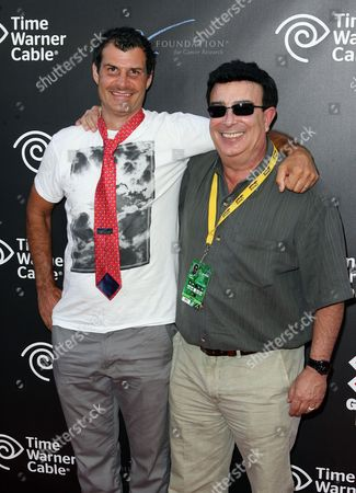 Mat Hoffman, left, and Ron Semiao attend the X Games Night of Film Benefit presented by Time Warner Cable, in Los Angeles