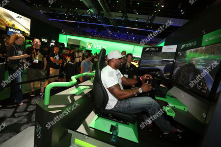 IMAGE DISTRIBUTED FOR MICROSOFT - MMA fighter Quinton Jackson interacts with Forza Motorsport 5 at E3 2014 in Los Angeles on
