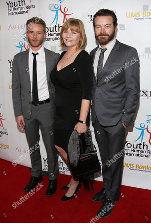 From left, Chris Masterson, Carol Masterson, and Danny Masterson arrive at Youth for Human Rights International Celebrity Benefit at Beso Hollywood on in Los Angeles
