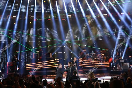 """Bo Bice, from left, Caleb Johnson, and Chris Daughtry perform at the """"American Idol"""" farewell season finale at the Dolby Theatre, in Los Angeles"""