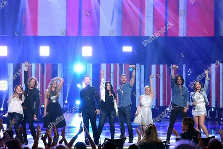 "Skylar Laine, from left, Bucky Covington, Lauren Alaine, Scotty McCreery, Kree Harrison, Ace Young, Kellie Pickler, Constantine Maroulis and Diana DeGarmo perform at the ""American Idol"" farewell season finale at the Dolby Theatre, in Los Angeles"