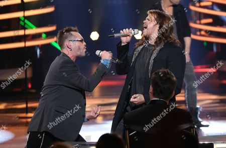 """Bo Bice, left, and Caleb Johnson perform at the """"American Idol"""" farewell season finale at the Dolby Theatre, in Los Angeles"""