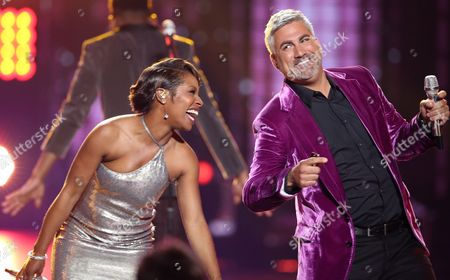 "LaToya London, left, and Taylor Hicks perform at the ""American Idol"" farewell season finale at the Dolby Theatre, in Los Angeles"