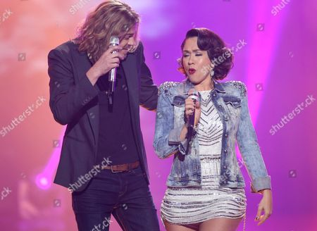"Bucky Covington, left, and Diana DeGarmo perform at the ""American Idol"" farewell season finale at the Dolby Theatre, in Los Angeles"