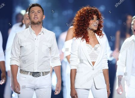 "Scotty McCreery, left, and Tamyra Gray appear at the ""American Idol"" farewell season finale at the Dolby Theatre, in Los Angeles"