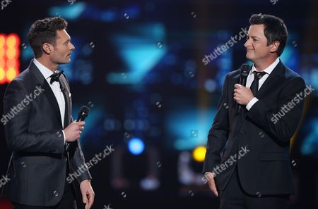 "Ryan Seacrest, left, and Brian Dunkleman speak at the ""American Idol"" farewell season finale at the Dolby Theatre, in Los Angeles"