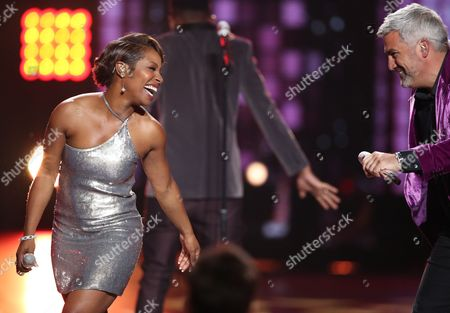 "Stock Photo of LaToya London, left, and Taylor Hicks perform at the ""American Idol"" farewell season finale at the Dolby Theatre, in Los Angeles"