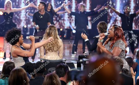"""Stock Picture of Melinda Doolittle, left, and Candice Glover perform at the """"American Idol"""" farewell season finale at the Dolby Theatre, in Los Angeles"""