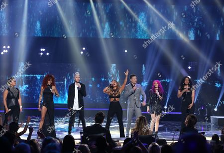 "Kimberley Locke, from left, Tamyra Gray, Colton Dixon, Pia Toscano, Justin Guarini, Allison Iraheta and Jordin Sparks perform at the ""American Idol"" farewell season finale at the Dolby Theatre, in Los Angeles"