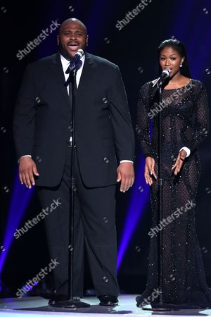 "Stock Image of Ruben Studdard, left, and Amber Holcomb perform at the ""American Idol"" farewell season finale at the Dolby Theatre, in Los Angeles"
